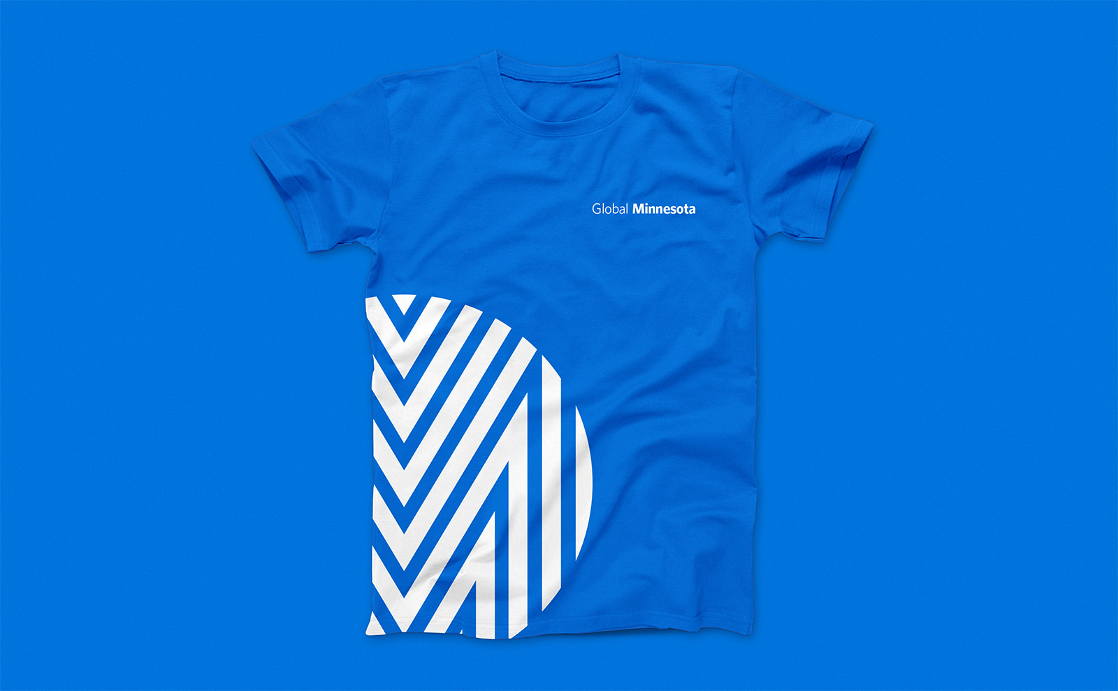 Global Minnesota logo on blue tshirt