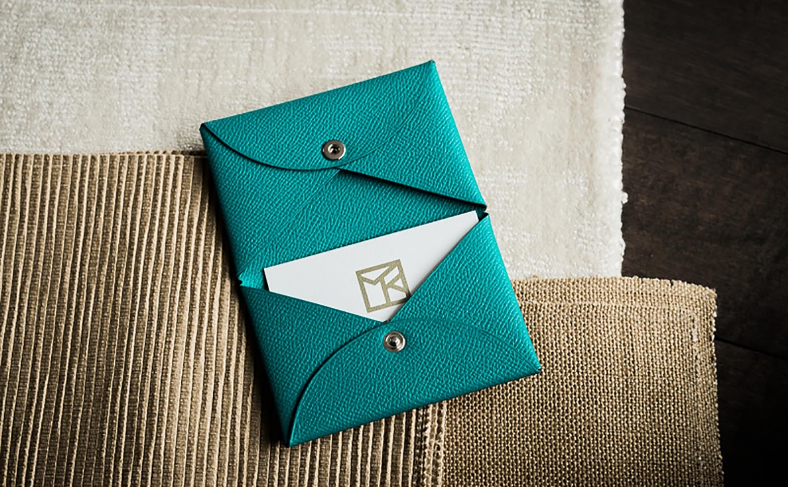 Morgan Kelly Interiors business cards and turquoise leather hermes card holder