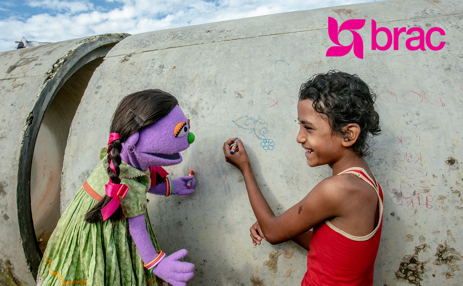 BRAC photo girl with puppet
